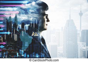 Businessman and stock data hologram