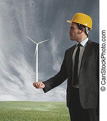 Businessman and wind turbine