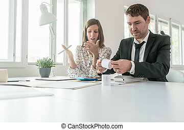 Businessman and woman doing their accounts
