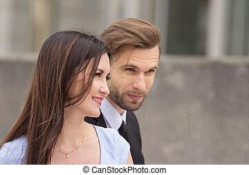 Businessman and woman flirting
