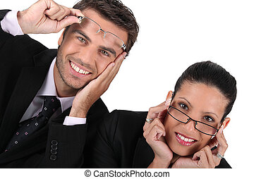 Businessman and woman in glasses