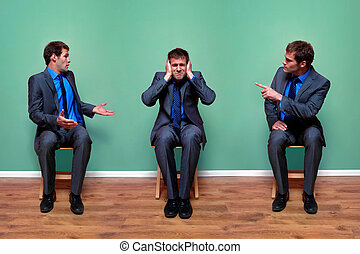 Concept image of a businessman having an argument with himself