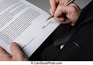 Businessman arm writing signature on contract
