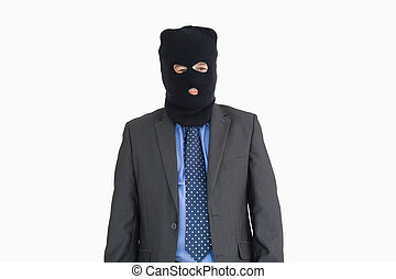 Businessman as a thief in a balaclava
