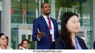 Businessman asking a question in a business seminar 4k