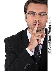 Businessman asking for quiet