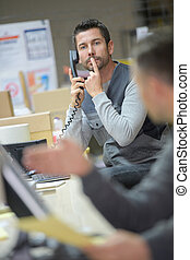 businessman asks silence during a successful telephone conversation