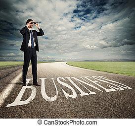 Businessman aspires to business success - Businessman looks...