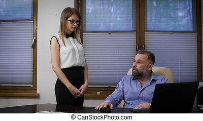 businessman assistant can not cope with the orders. A respectable man does reprimand his subordinate.