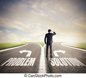 Businessman at a crossroads. He chooses the correct way. Concept of decision in business