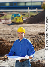 Businessman At Construction Site - Mature smiling...