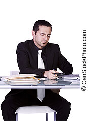 Businessman at His Desk Working - Isolated Businessman At...