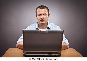 Businessman at his laptop