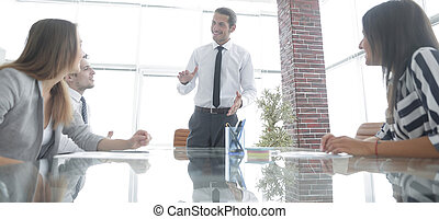 businessman at meeting with business team