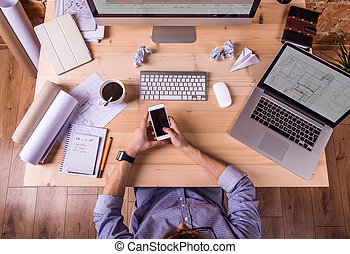 Businessman at the desk, office gadgets and supplies