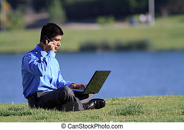 businessman at the park - young businessman working at the ...