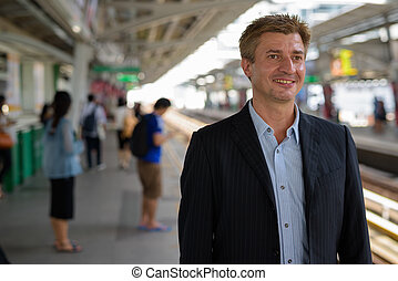 Businessman at the sky train station in Bangkok, Thailand