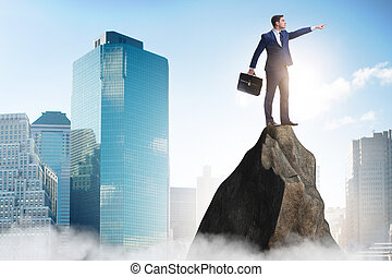 Businessman at the top of mountain
