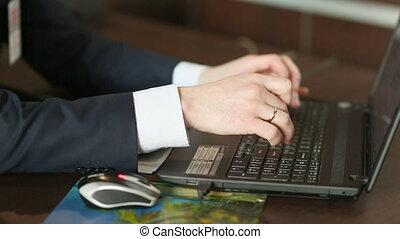 Businessman at work. Man working on black laptop.