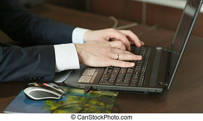 Businessman at work. Man working on black laptop.