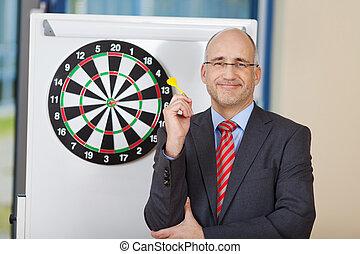 Businessman Attaching Dart On Target