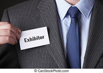 Businessman Attaching Name Tag At Conference