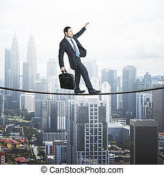 Businessman balancing on a string over the city, city view with scyscrapers in the background. Risk and self confidence concept