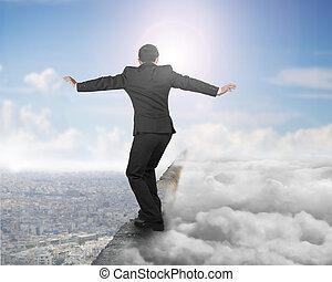 Businessman balancing on concrete ridge with sky sunlight cloudscape cityscape