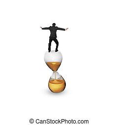 Businessman balancing on hourglass