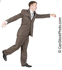 Businessman balancing on one leg