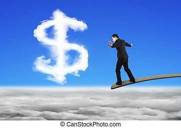 Businessman balancing on wooden board with dollar sign shape clo