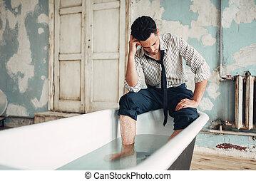 Businessman bankrupt in bathtub, suicide man