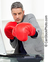 Businessman beating the competition