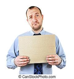 Businessman begging with cardboard sign
