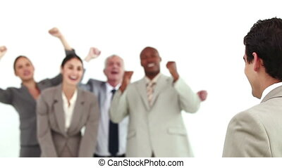 Businessman being encouraged by his team