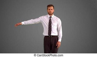 Businessman body popping on grey ba