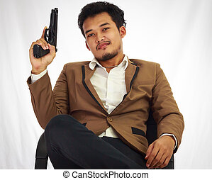 Businessman bodyguard on brown suit holding the gun