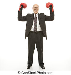 Businessman boxing gloves. - Smiling Caucasian middle-aged...