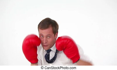 Businessman boxing with gloves