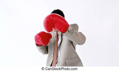 Businessman boxing with red gloves