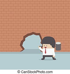 Businessman breaking the wall with