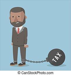 businessman burdened with taxes ball