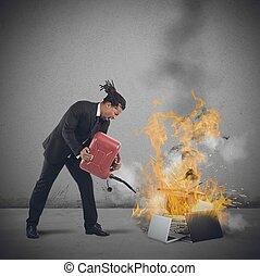 Businessman burns computers - A businessman stressed and...