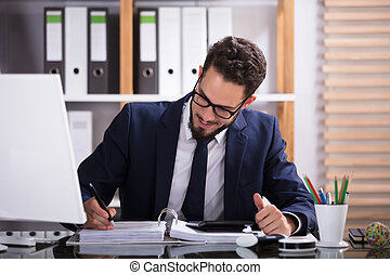 Businessman Calculating Bill