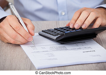 Businessman Calculating Financial Expenses - Midsection of ...