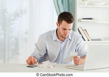 Businessman calculating his expenses