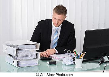 Businessman Calculating Tax