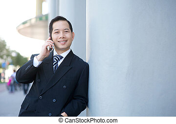 Businessman calling with cellphone