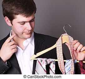 Businessman can't select a tie