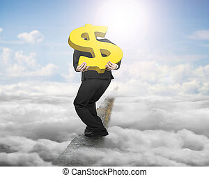 Businessman carrying gold dollar sign balancing on ridge with sky